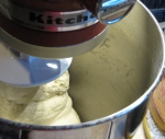 Mixer bread-dough is ready to shape when it pulls cleanly away from sides of the bowl.